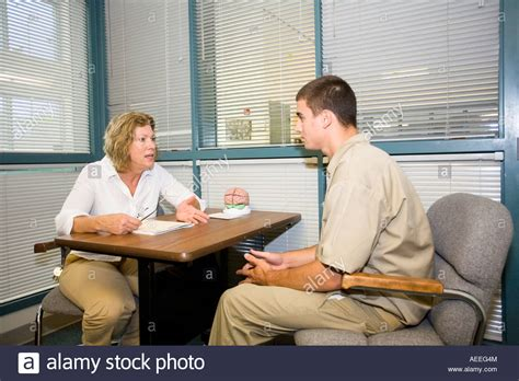 Youth Correctional Counselor mental health counselor talking to juvenile inmate at the nebraska stock photo royalty free