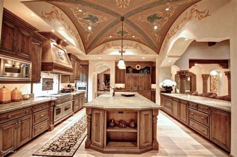 Mediterranean kitchen with high ceiling decolav granite countertop in
