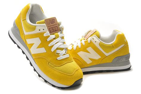 black and yellow new balance shoes