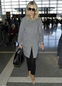 Gwyneth Ready To Get Back To Work by Gwyneth Paltrow Looks Ready For A Nap As She Boards Yet