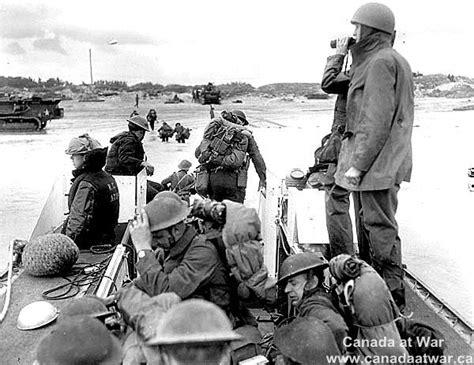 d day beach assault troops d day juno beach reinforcements going ashore from a lca landing craft assault from h m c s
