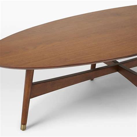 mid century oval coffee table reeve mid century oval coffee table pecan west elm