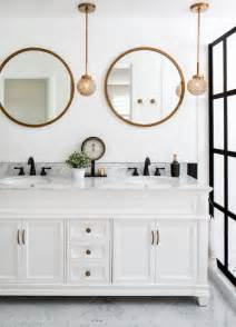 bathrooms with round vanity mirrors the interior collective