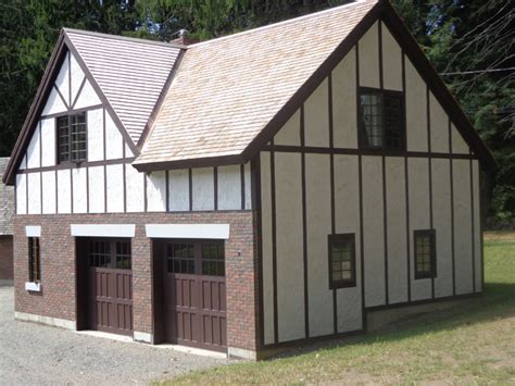 tutor barn shop designs tudor style garage garage and shed boston by