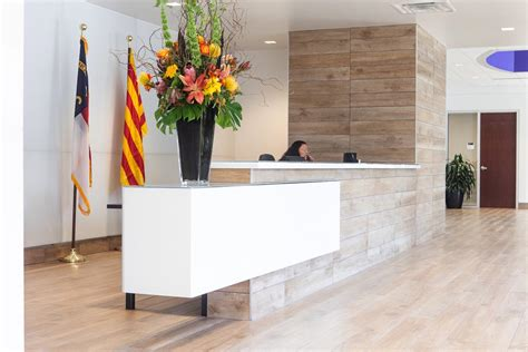 Tiled Reception Desk by A Sleek Tile And Glass Reception Deskhagersmith Design Pa