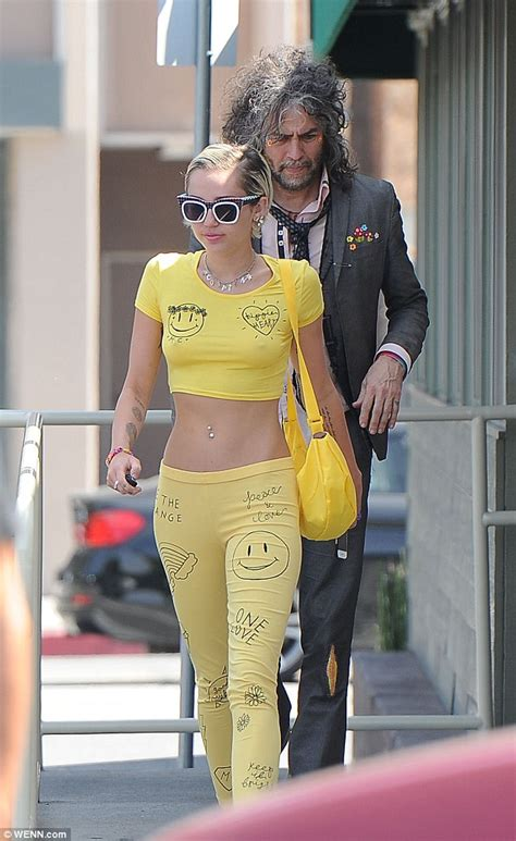 Miley Top miley cyrus goes braless in yellow crop top and matching