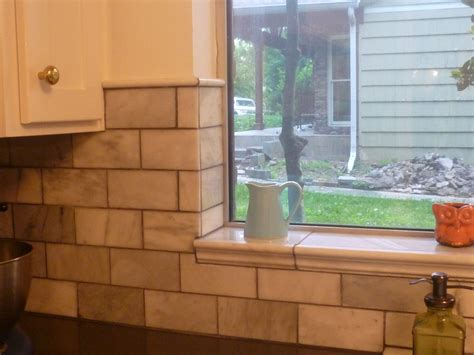 kitchen window backsplash showing off the tile around window and top of wall tiles