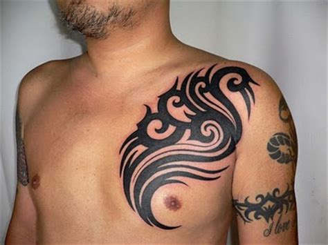 arm and chest tattoo tribal arm designs