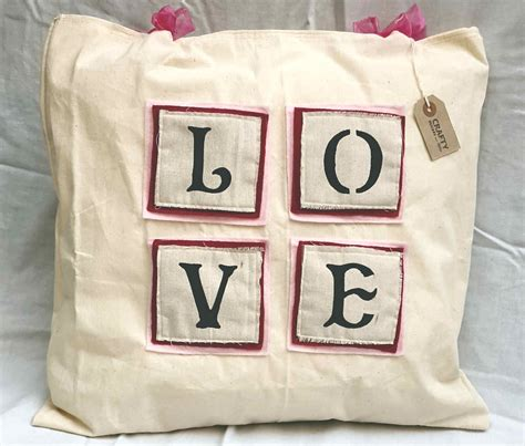 Handmade Soft Furnishings - calico patch design cushion with bows