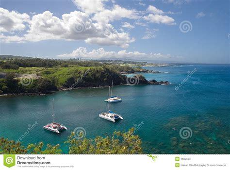 hawaiian catamaran molokai catamarans anchored at a pristine bay in maui hawaii