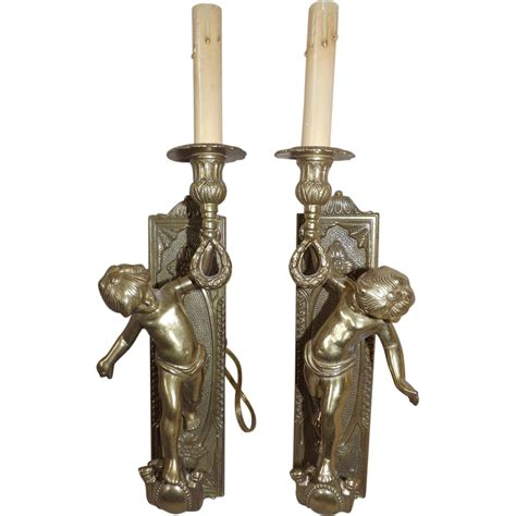 Torch Wall Sconce Pair Of Vintage Brass Cherub Putti Torch Wall Sconces From E3antiques On Ruby