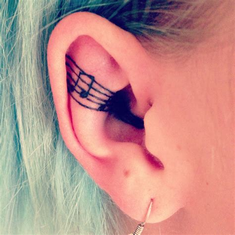music notes behind the ear tattoo