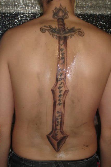 middle back tattoo large sword on middle back tattooshunt