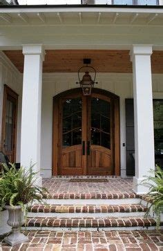 wooden porch posts and columns the rickety brick house the southern living idea house by bunny williams porch