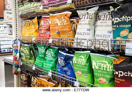 Shelf Of Microwave Popcorn by A Foods Grocery Store Aisle With A Shelf Of