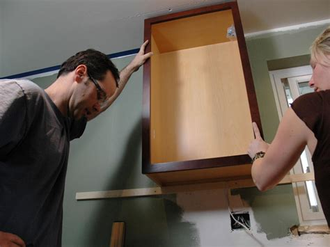 how to install upper kitchen cabinets kitchen catch up how to install cabinets how tos diy