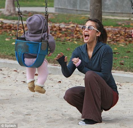play tv swing jessica alba is the doting mother as she takes baby