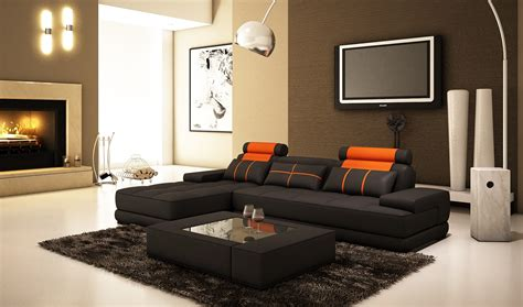 modern living room interior design with black l shaped sofa furniture using orange headrest and