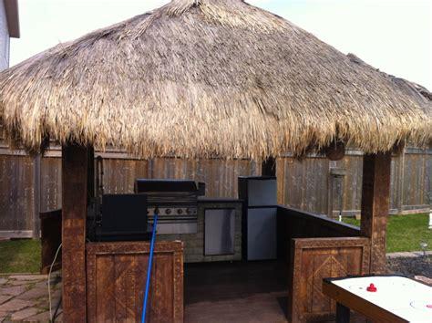 backyard hut tiki hut party happy or hungry