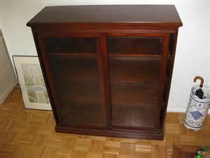 wood bookcase with glass doors photo