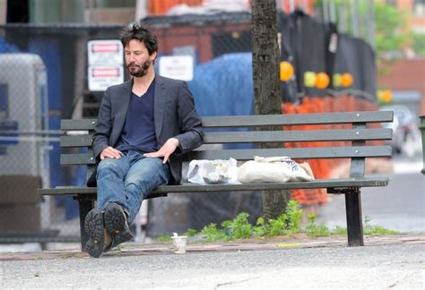 keanu reeves on a bench the amazing story of how keanu reeves gave away 75
