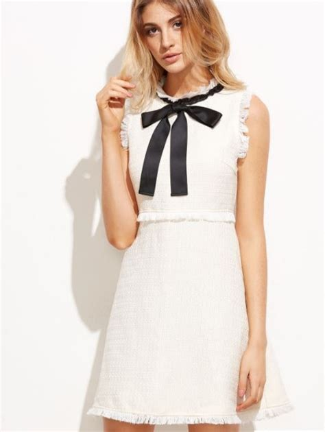 Dres Channel chanel like white dress with black bow shopping and info
