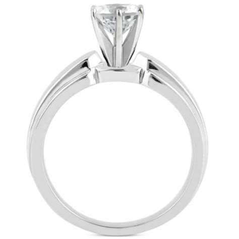 cathedral style prong set solitaire engagement