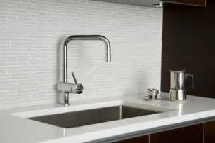 white glass tiles backsplash contrast dark cabinetry