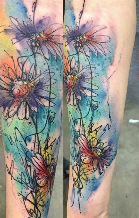 watercolor daisy tattoo by bryan sanchez from into the