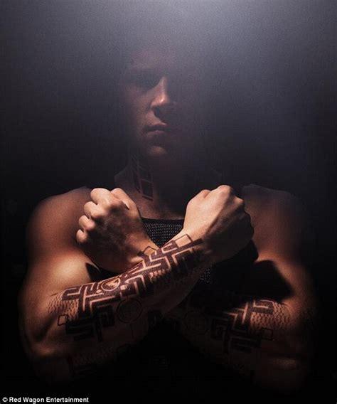 jai courtney tattoo zoe kravitz displays tattooed bicep and wields a knife in