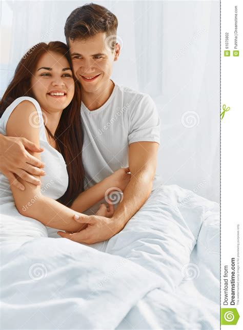 how to romance a woman in bed portrait of couple in love in bed stock photo image