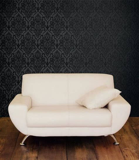 wallpaper to go with grey sofa black damask on darky grey accent wall behind couch note