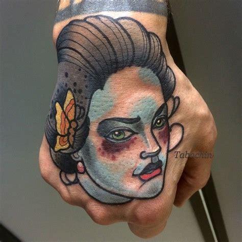 tattoo hand fish done by dmitriy tabachin tattoo artist at mad fish tattoo