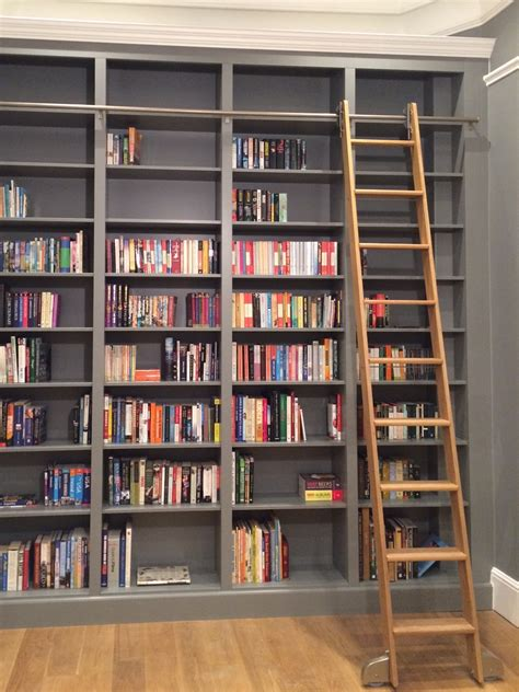 bespoke bookcase in with sliding oak ladder by