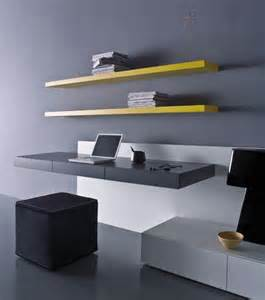 minimalist home oofice with black bench hanging desk with