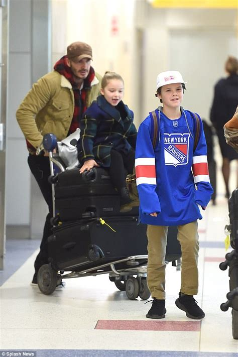 Reunited Posh By Davids Side As He Spends Another Day With Sick by David Beckham Pushes On Trolley At Jfk Airport
