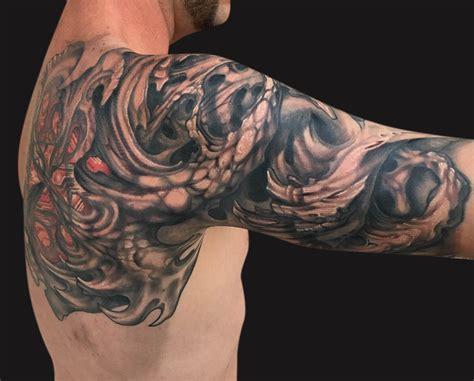 bio tattoos bio mechanical shells on right half sleeve
