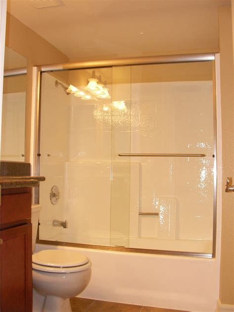 bathtub shower enclosure large sliding glass door combined with silver steel towel
