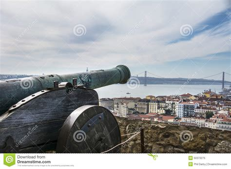 a cannon in the ground of the castle sao jorge stock image