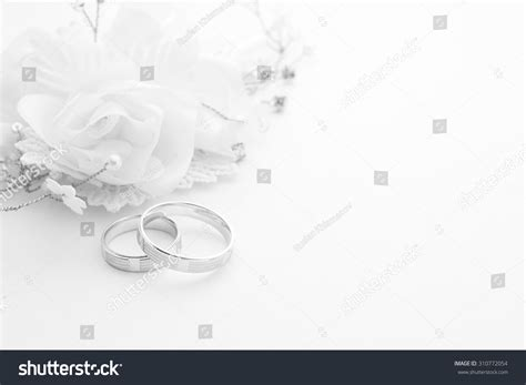 Wedding Background And White by Wedding Rings On Wedding Card On Stock Photo 310772054
