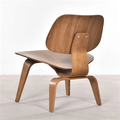 eames lcw walnut lounge chair for herman miller at 1stdibs