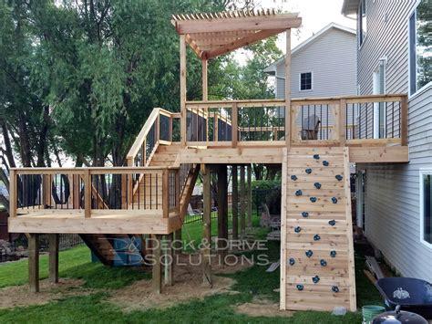 slide deck new cedar deck with slide and rock wall des moines deck