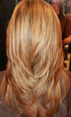 shaggy strawberry blonde perm long layered haircuts back view medium length layered