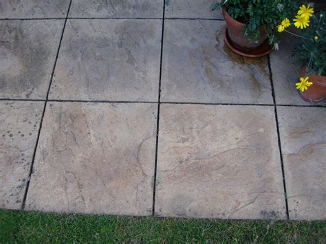 extension of small patio with paving slabs landscape