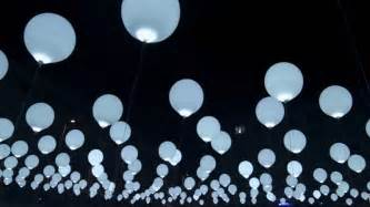 large white lights balloons colossal