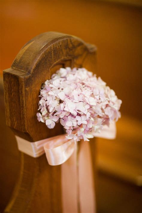 Hydrangea as church wedding aisle decor. Photo by borrowed