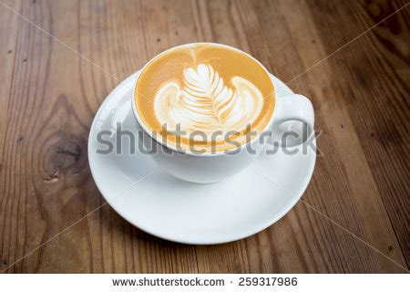 latte art leaf pattern three cups hot cafe latte differences stock photo