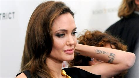 angelina jolie tattoos sacred fearless designs meanings