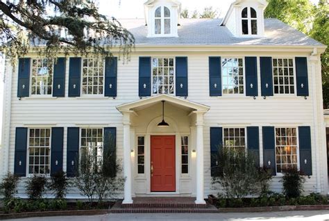 white house with blue shutters navy shutters on pinterest grey exterior paints colonial house exteriors and blue