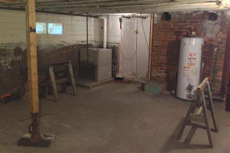 basement floor joists adding support to a floor joist in the basement avoision